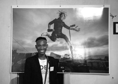 Phuti, in front of a photo of himself in the Hub