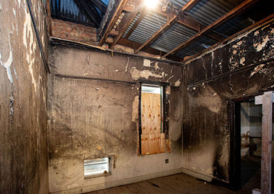 A room in the hub that suffered fire damage